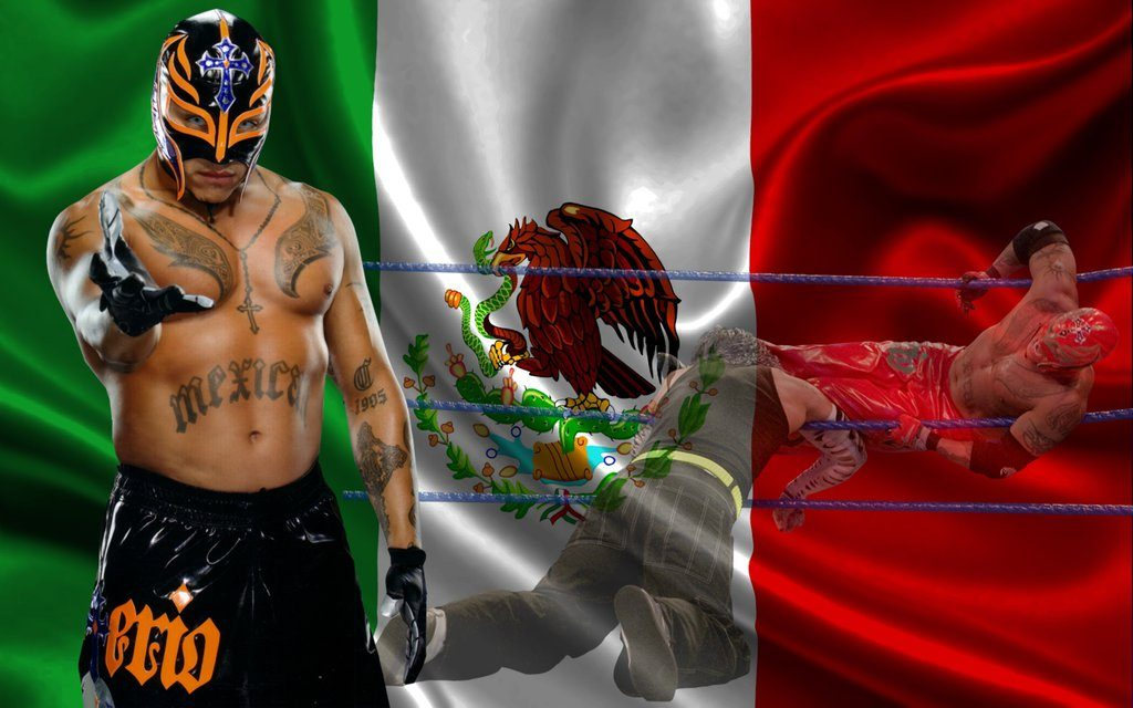 rey mysterio con la bandera de mexico de fondo